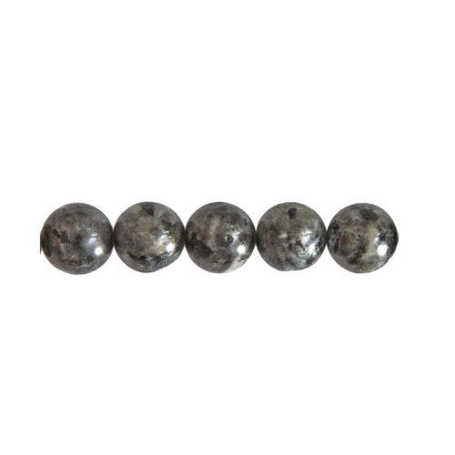 perle ronde avec inclusions